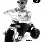 Under a black and white Apple podcast logo. Is A black and white portrait of an African American boy riding a tricycle with dark black shades. The text on the picture reads: Before Brown Boy Bad(?) [Note the question mark stands out in red] Successful Black fathers on childhood racism