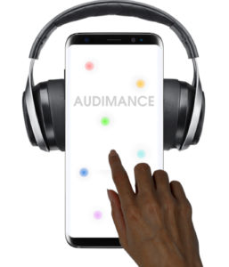 "A mobile phone screen sports several pastel colored dots'; the word ""Audimance"" is visible. The dots represent different soundtracks, and a brown skinned hand reaches into the image pressing on a dot and thereby choosing a mix of tracks."