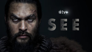 Jason Momoa as Baba Voss stares out past the camera. His eyes are white, face is scarred. See from Apple TV Plus