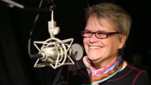 Image of Cathy Kudlick in front of a microphone