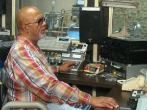 Robert Lewis at work at the Radio Reading Network of Maryland