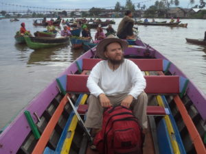 Tony in a small local boat, floating market in Banjarmasin, capital of South Kalimantan, Indonesiam 2015