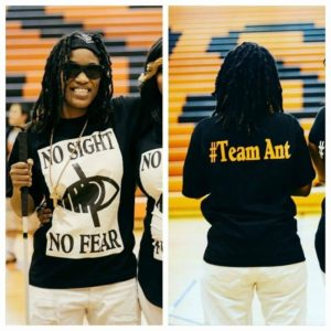 "Split image with left side featuring Young Ant sporting a t-shirt reading ""No Sight"" followed by a image of an Eye with a slash running through it and beneath ""No Fear"". The right side image is of Young Ant with the reverse side of t-shirt reading ""#Team Ant""."
