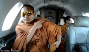 Picture of Monks with sun glasses on a plane